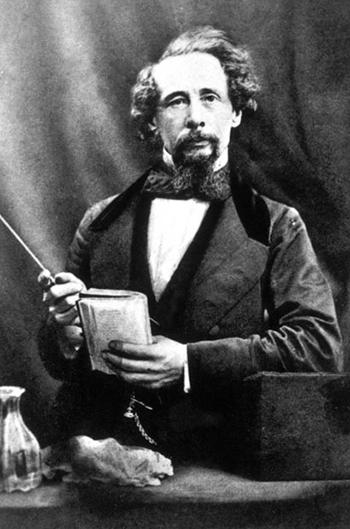 charles dickens holding a manuscript adaptations of a christmas carol - Charles Dickens A Christmas Carol Adaptations
